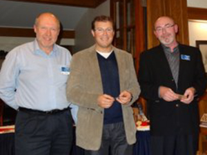 "Mark Heine and co-owner Paul Roberts (SV Saturnus) receiving their ""Offshore Owner"" award from Past Commodore, Boudewijn Neijens"