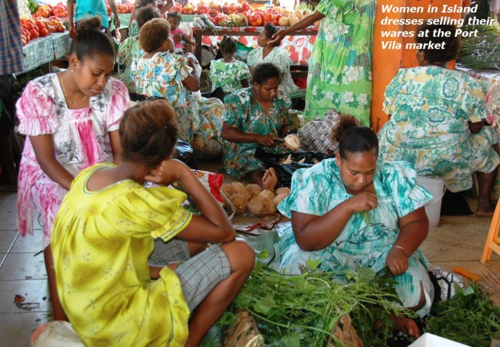 Women in island dresses selling their wares at the Port Vila market