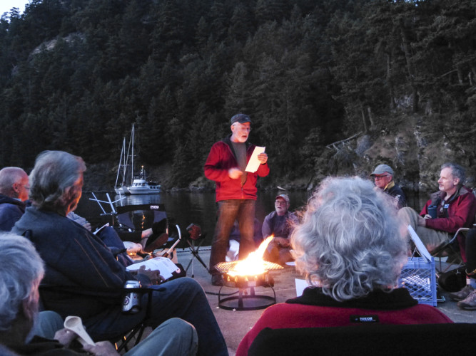 Gathered around the campfire for songs and social time after dinner