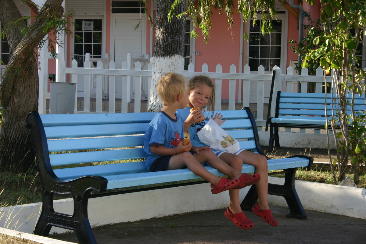 The kids enjoy a pain au chocolat in Les Saintes