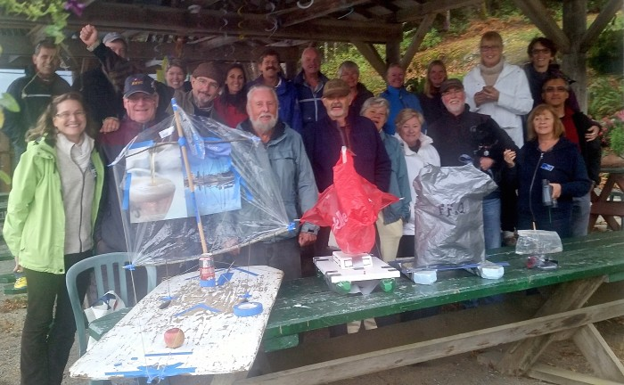 Model boat builders and spectators gather for a group photo prior to the race.