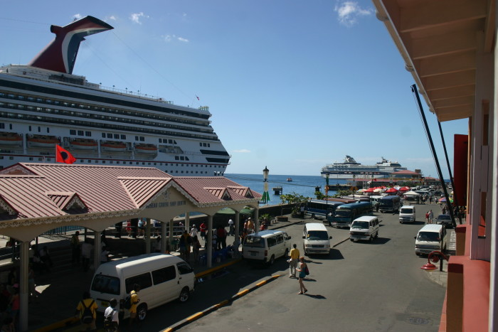 A warm welcome awaits from the taxi drivers and souvenir vendors at the Roseau Cruise Ship dock